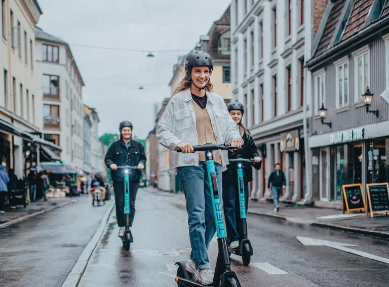 Where are shared e-scooters and e-bikes available in the UK?